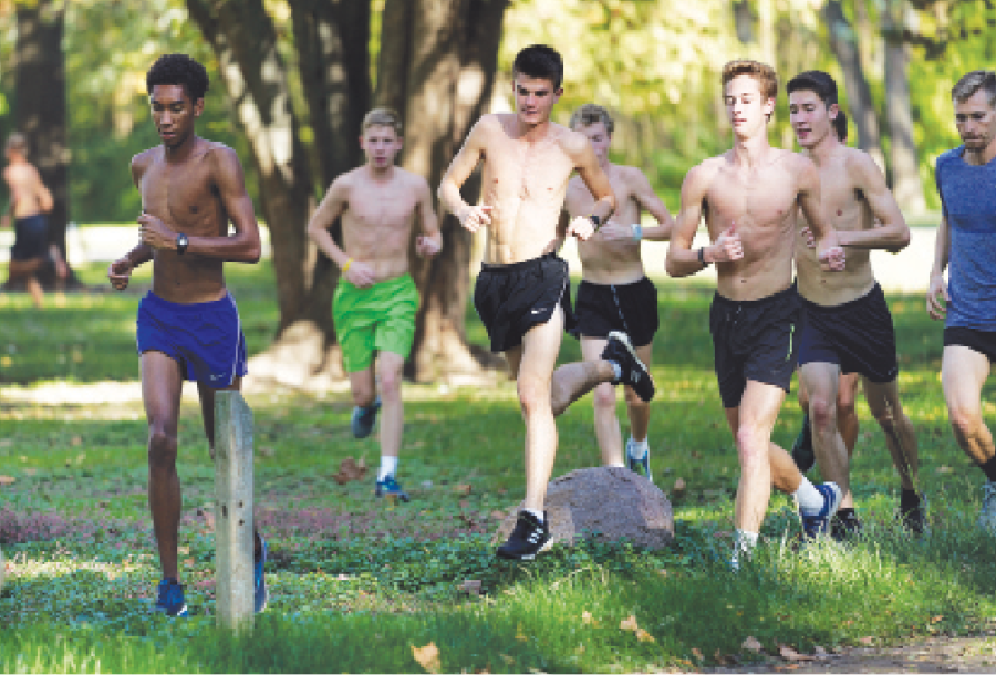 LIGHT WORK: The men's cross country team runs during a practice. Head Coach Colin Altevogt says having a surplus of varsity level runners also the top runners to rest and prepare for State. MAY ZHANG | Photo