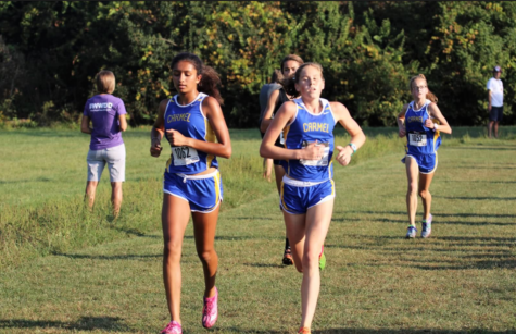 Junior Izza Khuram (1062) leads the pack at MIC Championship meet at Ben Davis High School on Sept. 23. Carmel finished in first place at the meet, continuing a streak that has lasted over a decade.
