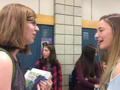 Senior Kendall Fahey converses with fellow senior Anna Prall in the morning before first period. According to Fahey, the PTO helps to facilitate a collective environment at CHS by creating events that allow for students to interact with their peers outside of the classroom.
