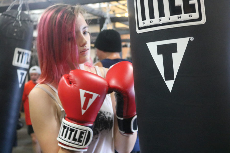 """Freshman Jenna Hohne boxes at Title Boxing Club. She said she boxes to reduce stress. Hohne said, """"Most people don't really know I box; it's not like a secret I keep, it's just not something that comes up."""""""
