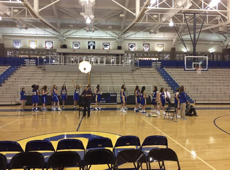 The girls' basketball team lines up for pictures. Amy Dilk, varsity player and senior, has high hopes for the season