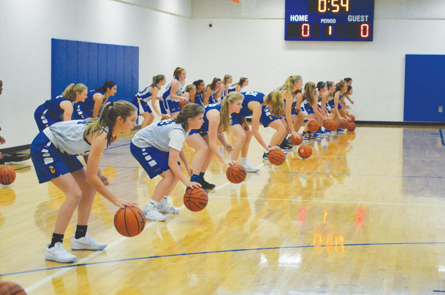 The CHS women's basketball team warms up for practice as their season begins to pick up. This year the team will face one of the toughest schedules in the state.