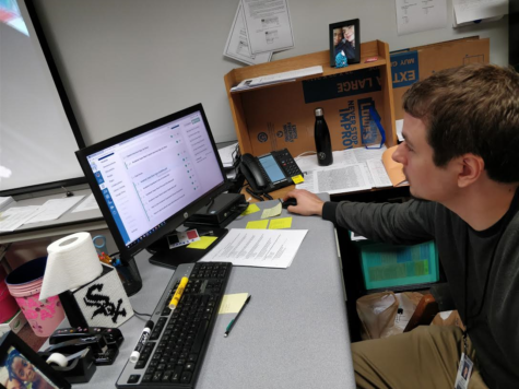James Ziegler, Academic Super Bowl co-sponsor and social studies teacher, checks the Academic Super Bowl Canvas page. Ziegler said this year the club had many strong candidates for the captain positions.