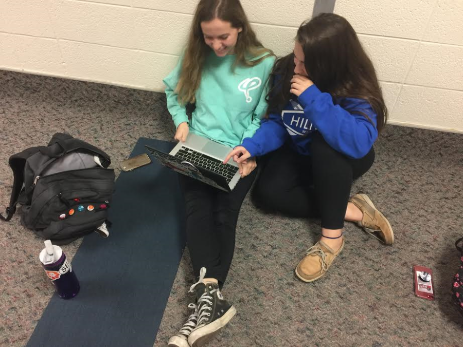 Abby Carmichael, Teen Library Council vice president and sophomore, and Kassandra Lynn, Teen Library Council president and sophomore, work on the next Teen Library Council meeting talking points. The biggest event that the Teen Library Council hosts is the Yule Ball in January.
