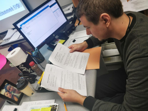 James Ziegler, Academic Super Bowl co-sponsor and social studies teacher, looks over two captain forms recently submitted to him. He said,