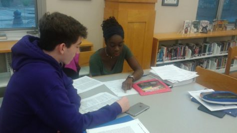 Seniors Nick Schipp and Oti Ogbeide discuss their AP Macroeconomics work. Schipp said the new suicide prevention and awareness policy the board will discuss in November was relevant and possibly beneficial to students.