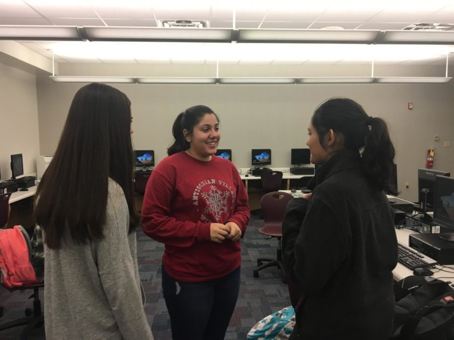 Sophomores Natalie Khamis, Alyssa Smith and Anushka Dasgupta discuss plans for the street store project at the Design for CHS meeting on Nov. 14. At this meeting, Design for CHS members continued to work on plans for the upcoming street store event.