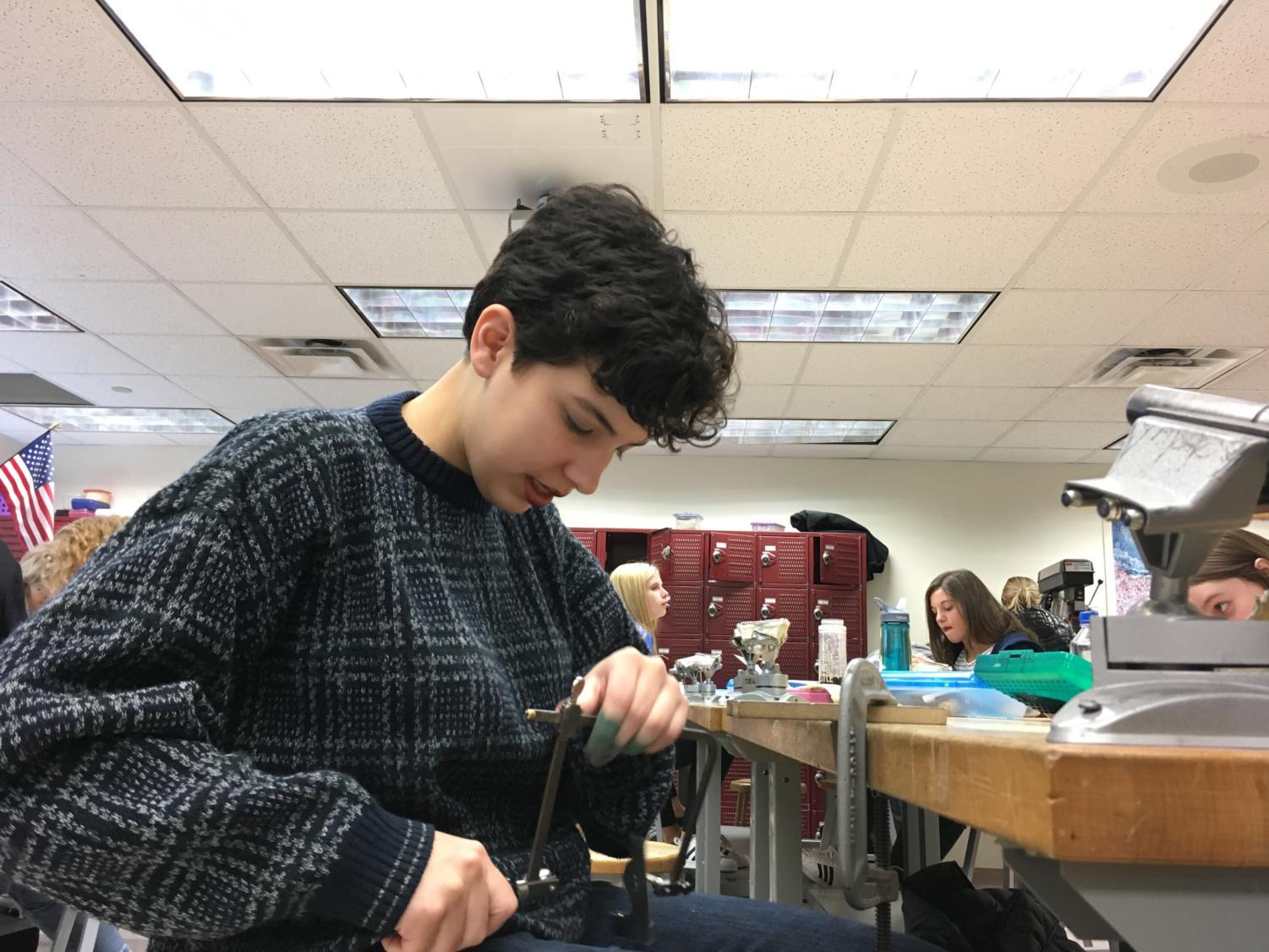 "Mackenzie Gonzalez, senior and lead actress in ""Up the Down Staircase,"" works to create a piece of jewelry during class. Gonzalez said rehearsing for the fall production has not created any serious conflicts in her schedule, and she is still able to take on projects such as the one pictured."