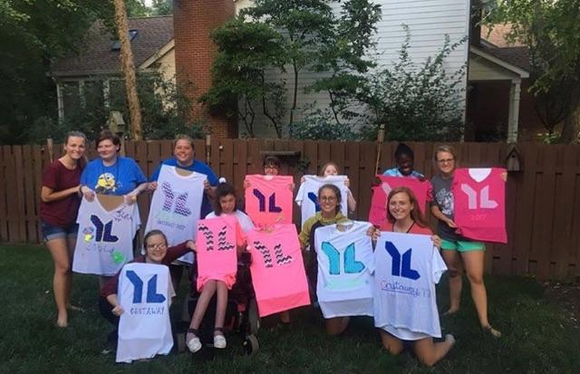 Members of Young Life Capernaum hold up shirts they have created at a meeting. The last meeting took place today at 6 p.m. (Submitted photo, Bryn Walker)
