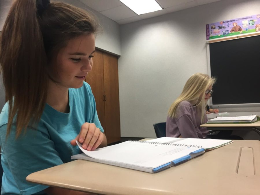 """Sophia Pecoraro, Best Buddies officer and sophomore, works on homework during SRT. Pecoraro said, """"I really like just having time to talk to people."""