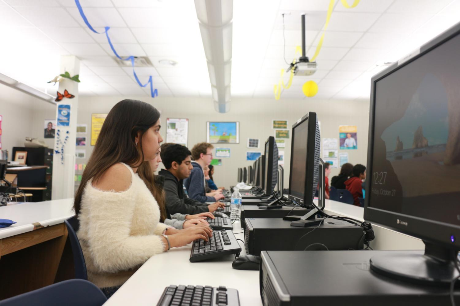 Students learn how to code in Python, a programming language, through a hands-on learning approach during AP Computer Science Principles (AP CSP). AP CSP teacher Theresa Kane said she believes the class is helping to close the gender and minority gap.