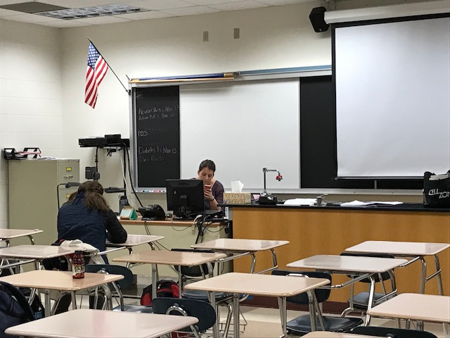 Club Med sponsor, Alyssa Mastin waits as students from her first period Human Body Systems (HBS) class start to arrive. Both Club Med and HBS are based on biology and human anatomy. 