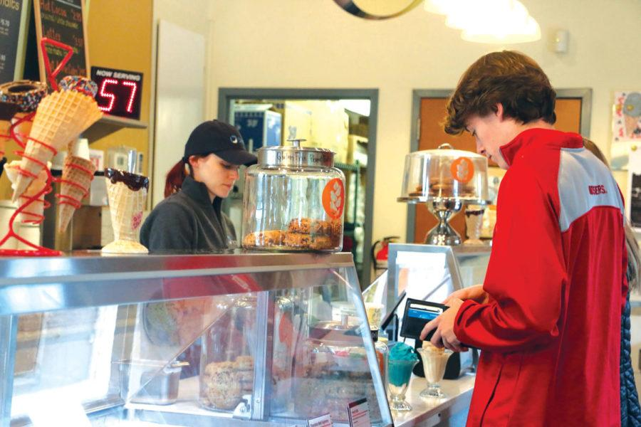 A BRICS customer pays for his ice cream. According to BRICS owner David Vonnegut-Gabovitch, BRICS uses glass ice cream cups to maintain a welcoming atmosphere.