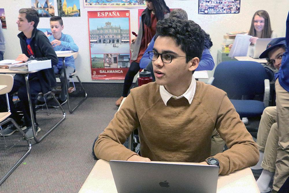 Sophomore Ayman Bolad prepares for a presentation in his Spanish class. Bolad said this trip gave him more exposure on Spanish culture and language.