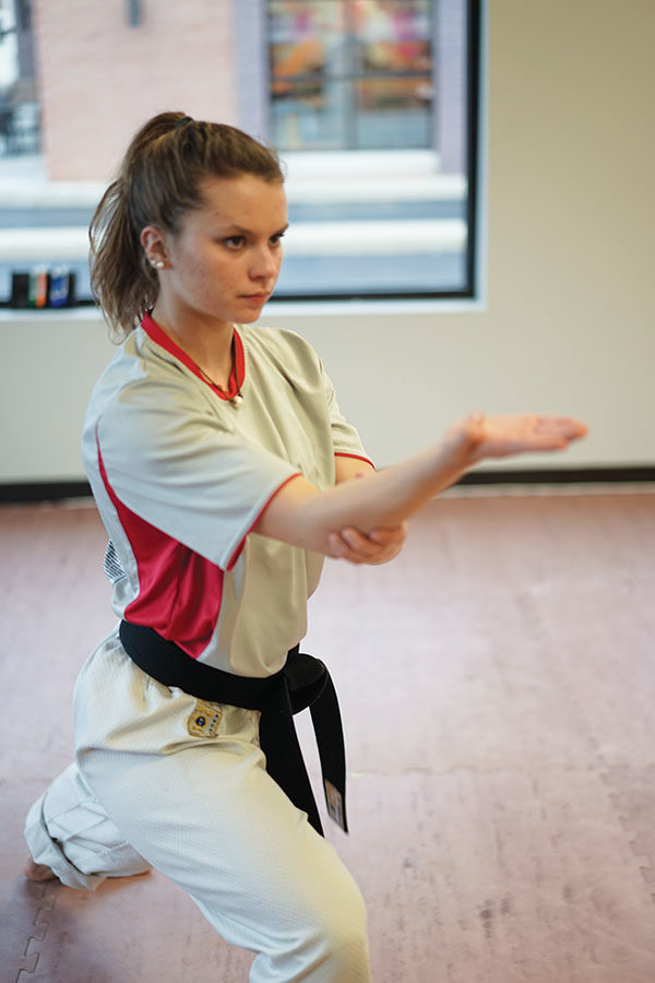 Hope Adamson, karate student and junior, practices at the Adamson Karate Studio. She said her family's involvement in martial arts goes back to 1977. MAY ZHANG | Photo
