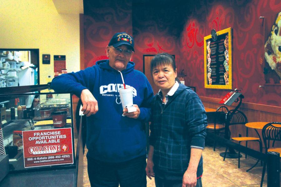 Cold Stone Creamery owner Jenny Qiu stands with long-time customer and veteran Robert Harter. According to Qiu, Harter has been coming to the store since its opening nine years ago.