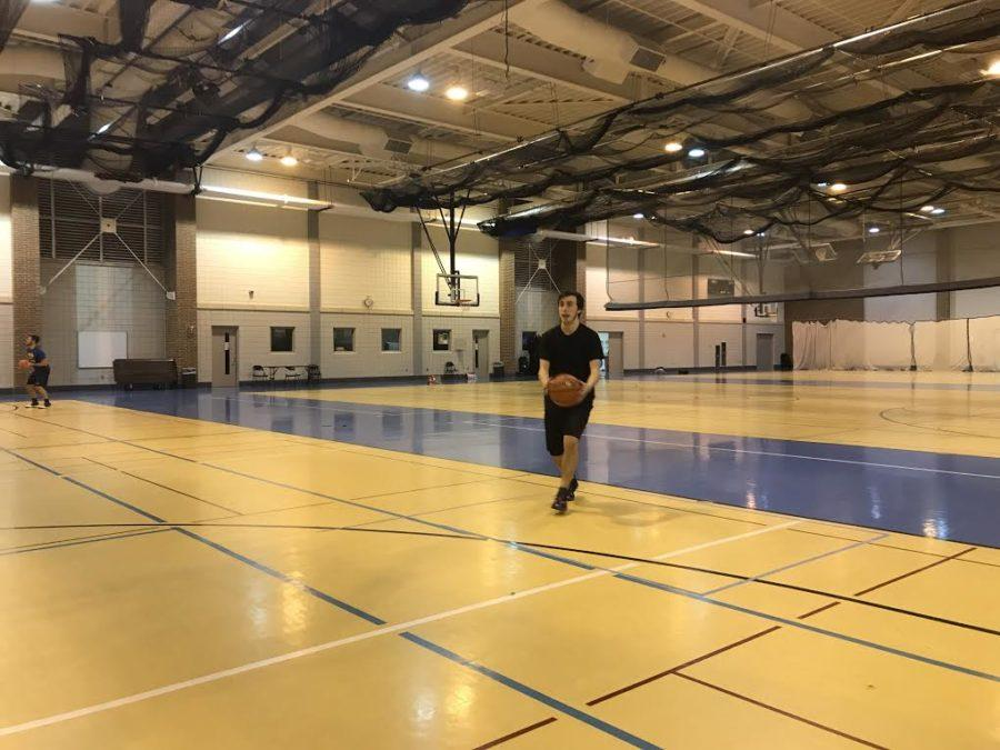 Jack Engledow, Intramurals player and senior, prepares to shoot a three pointer during warm-ups. The Intramural callout meeting is scheduled for mid December.