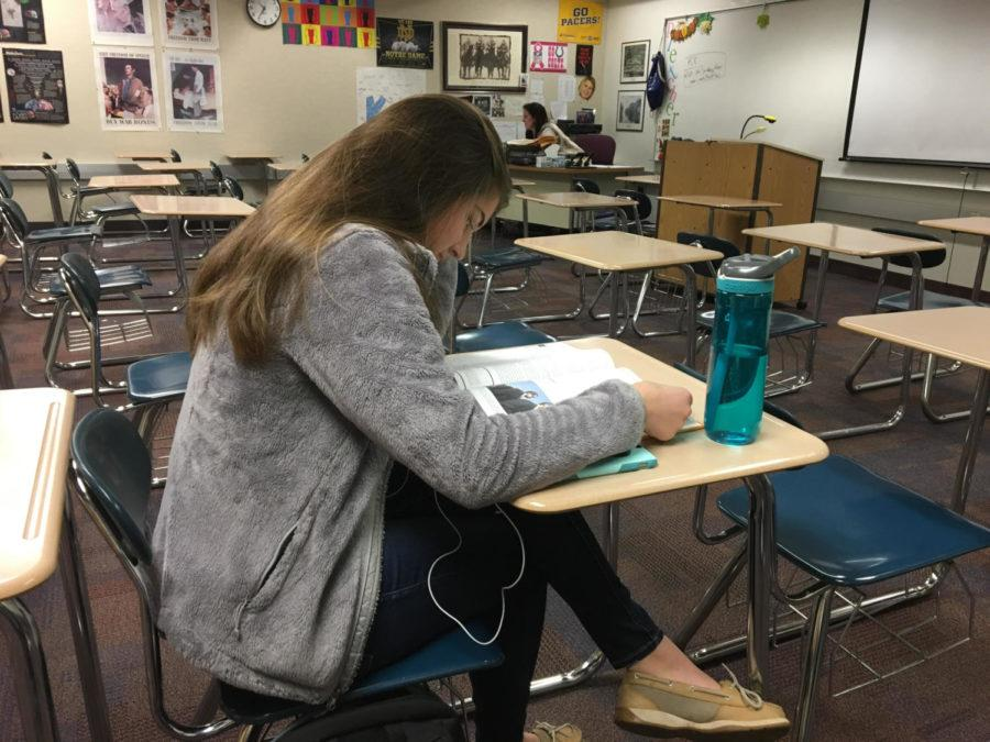 Breana Davis, K-8 mentor and senior, studies during SRT under the supervision of Robin Pletcher, AP Psychology and K-8 mentoring teacher. All mentors were assigned four students from Carmel elementary schools and are now driving out to their mentees during third block of Gold Days. Davis said,