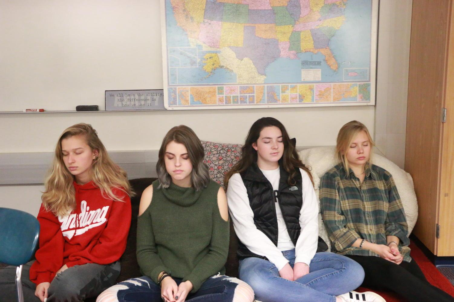 Theory of Knowledge (TOK) students work on their breathing meditation. Junior Aubrie Bradbury (second from the right) said she found out about mindfulness during her freshman year, but during TOK, she got back into practicing mindfulness, which has been helpful for her.