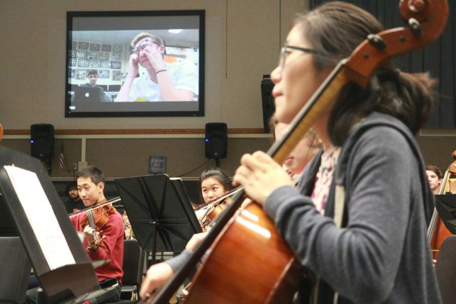 Junior Selin Oh plays the music going along the IB film on her cello. In order to prepare for the concert, Symphony focused on musicality in order to portray IB film students' desired effects.