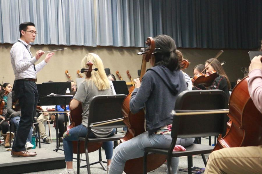 Tom Chen, assistant director of orchestras conducts the cello section through a part of their music. In order to match the movie, elements such as style and tempo had to be taken into consideration.