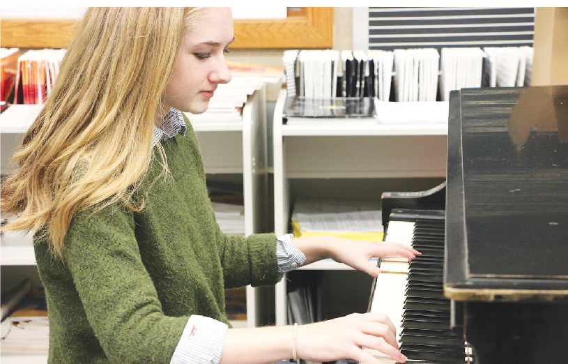 SCALING IT: Senior Emma Hedrick plays scales on the piano as part of her morning warmup for Jazz Ensemble. Hedrick is a member of Share the Music and also sings and plays jazz music for the club.