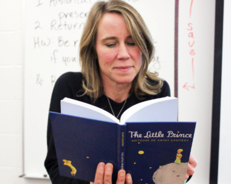 English teacher Katie Overbeck reads The Little Prince before class begins; according to Overbeck, her International Baccalaureate (IB) classes are currently reading the book in class.