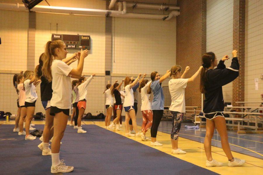 Winter Cheerleaders practice their cheers for basketball games. Blue and Gold cheer teams cheer for both boys and girls basketball, but they alternate which games they cheer so that the team isnt overwhelmed by the schedule.