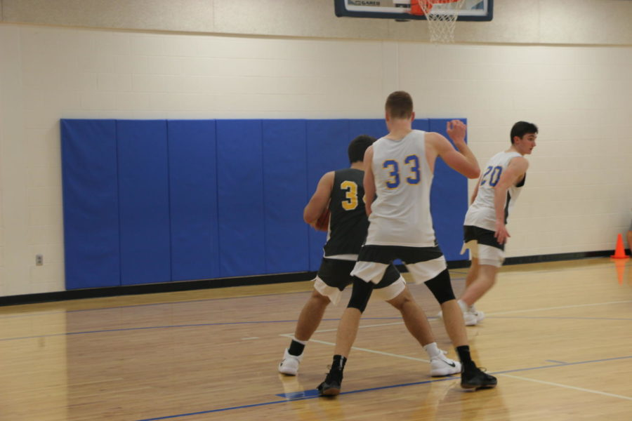 The boys' basketball team practices for their upcoming game against Noblesville. Currently, JV and varsity have a  2-1 win to loss record.