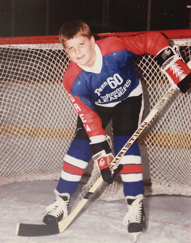Science teacher Drew Grimes as a child, pictured posing for a team photo. Grimes played hockey through high school and currently plays on and adult league on Monday nights at the Carmel Ice Skadium.