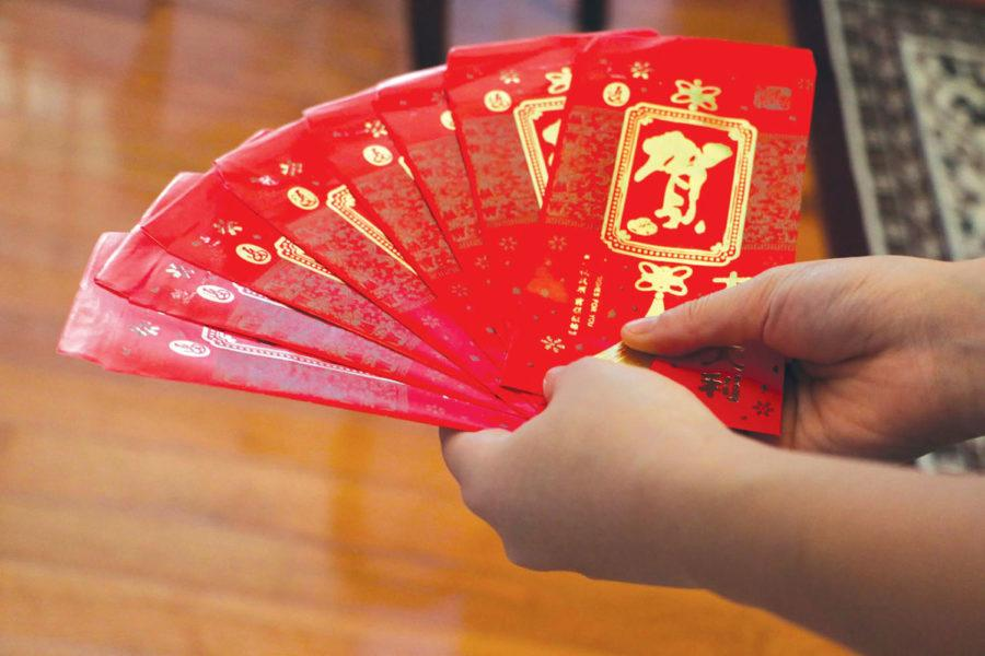 Sophomore Chendi Liu displays the red envelopes she receives money in during Chinese New Year. Liu said she used to travel to China to celebrate this holiday, but an increased workload at school prevented her from going this year.