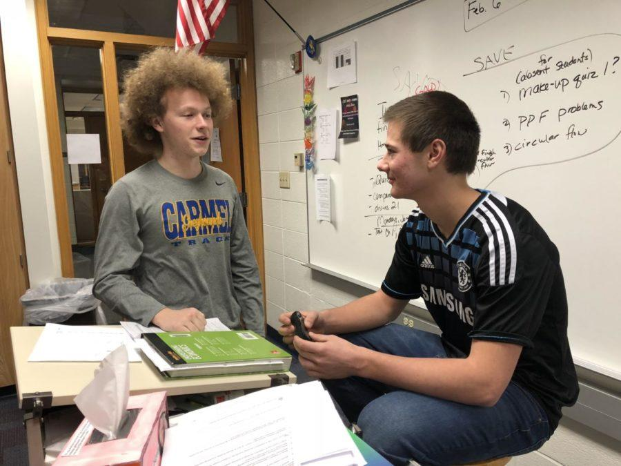 Senators and juniors Connor Inskeep (left) and Tim Metken (right) plan for the winter dance during SRT. The winter dance serves as Senate's only fundraiser for the year.