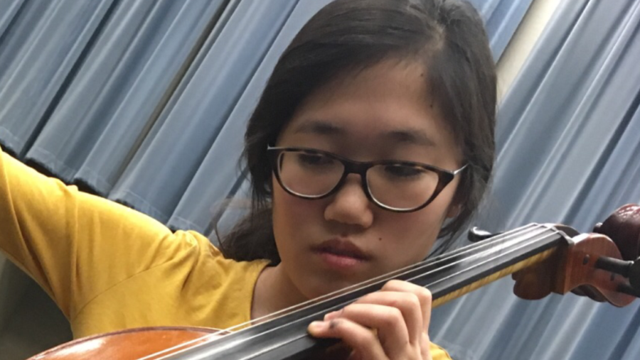 Selin Oh, Camerata Orchestra cellist and junior, practices her cello in the orchestra room after school. Ohly-Davis said light refreshments, namely cookies and punch, will be served at the event.