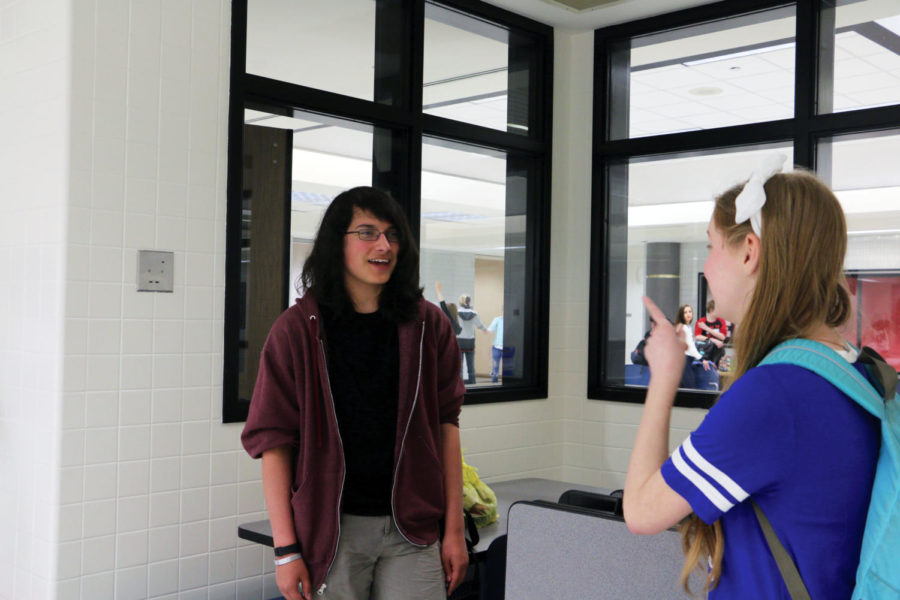 Robert Sanchez, Goalball Club president and sophomore, talks with Alexandra Lawburg '17, former Goalball Club member and alumna, about club developments. Sanchez said the club has been working on drills and improving its skills as a team.​