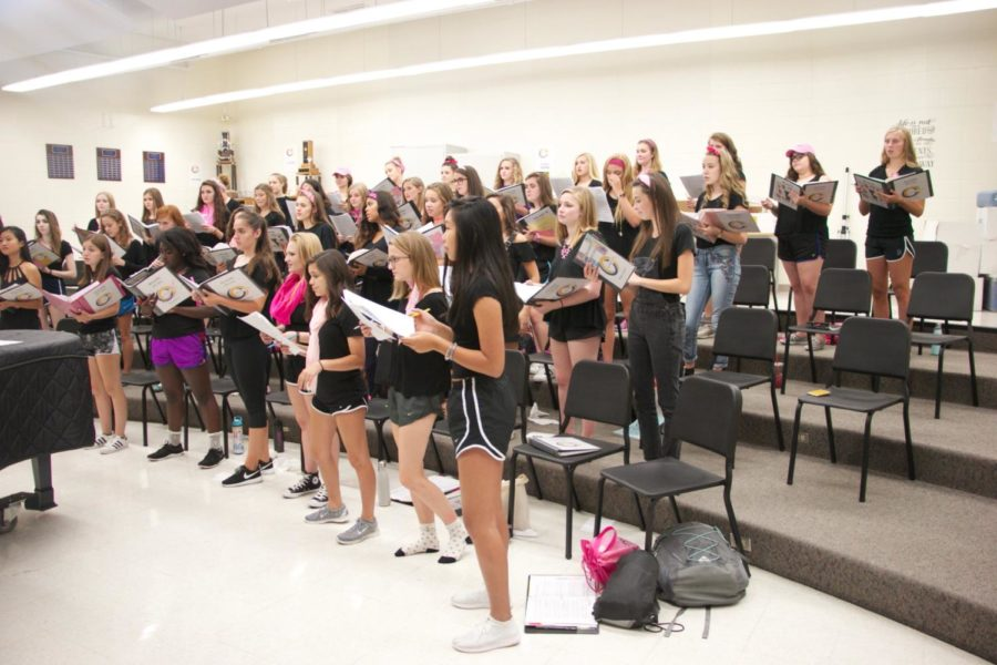 Accents read and vocally rehearse songs at an evening rehearsal. Since the beginning of the year, the choir has learned and rehearsed music to be performed this competition season.