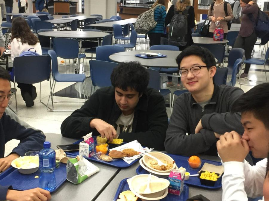"""Senior Ian Samir eats lunch with his friends. Samir said, """"I'm really happy about intramurals. It lets me play basketball with my friends."""