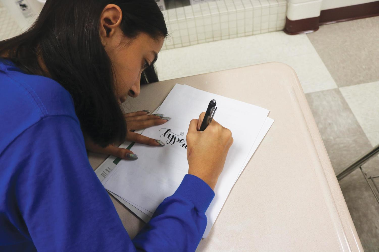 """Sophomore Reagan Smiley is creates a piece. She said, """"I do calligraphy to express myself."""""""
