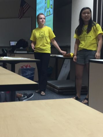 Hannah Bromm and Nyssa Qiao, Project Sunshine Co-presidents and seniors inform members on how to construct the craft kits. 