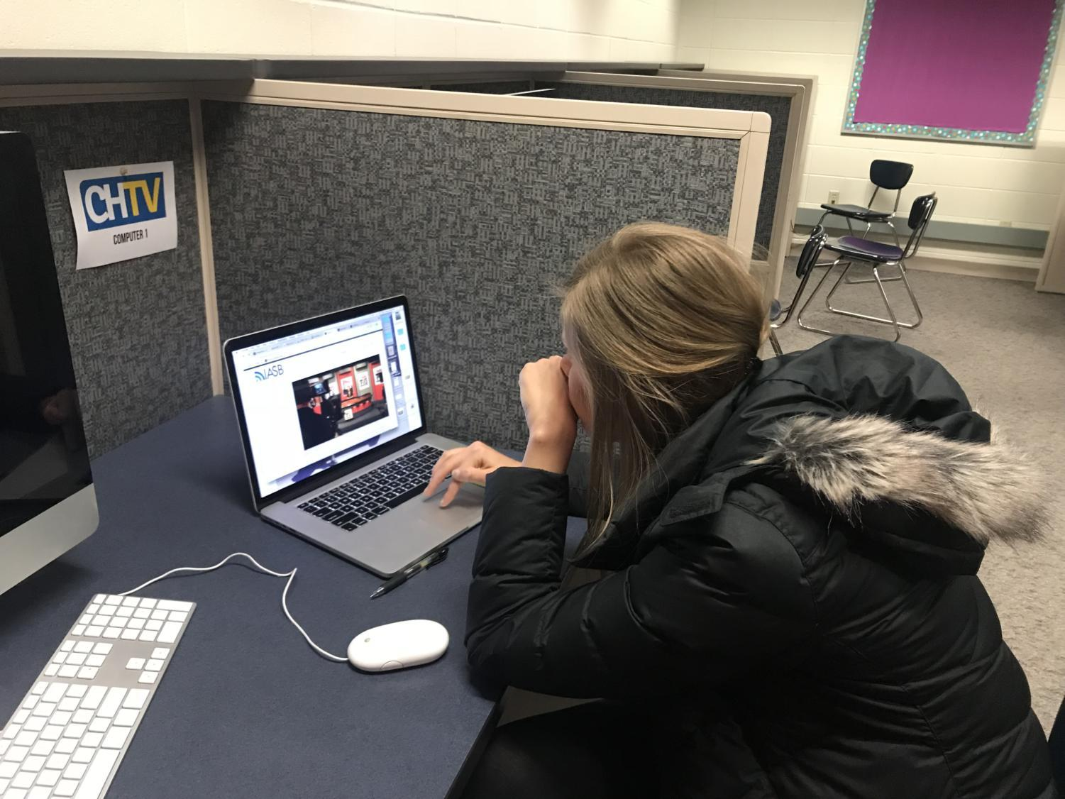 Anna Kaiser works on the next broadcast in the CHTV editing lab on Feb. 23. Kaiser worked with Stephen Abshire, CHTV staff member and senior, in the lab for the whole period that day.
