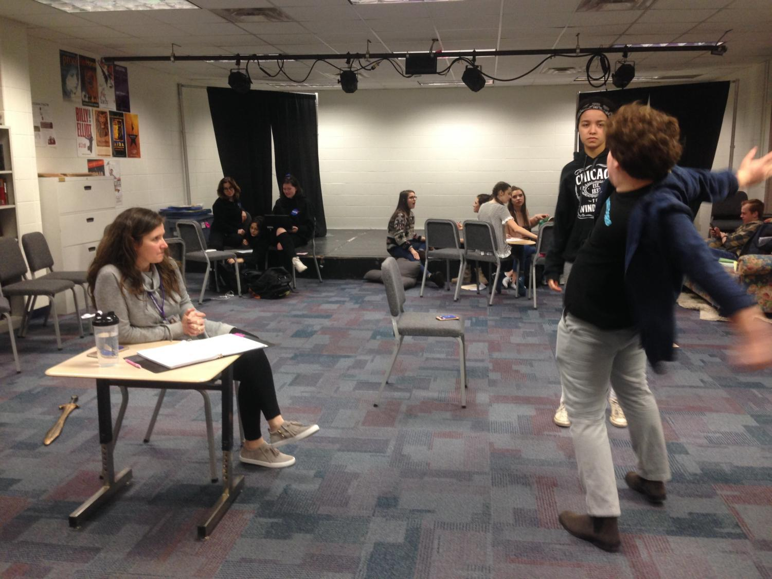 "Maggie Cassidy, director of ""Peter and the Starcatcher"" and theatre arts teacher, watches members of the cast practice their scenes to ensure it is ready to piece together with the rest of the production. Cassidy said for the most part, the musical is ready for opening night."