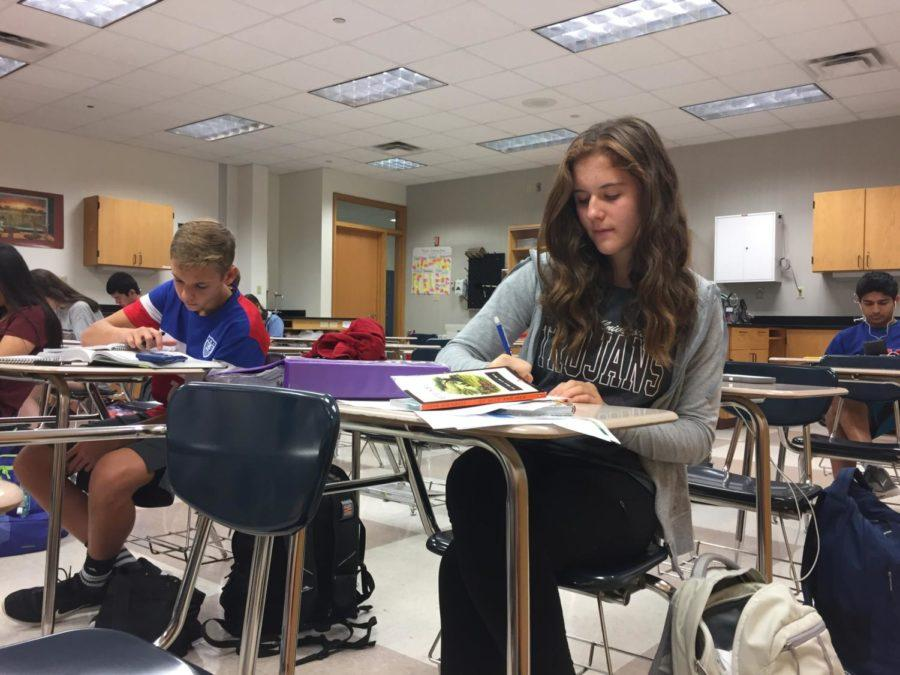 Best Buddies club officer Molly Shaffer works on homework during SRT. Shaffer said she loves being part of Best Buddies and is very excited for the upcoming Valentine's Day party.