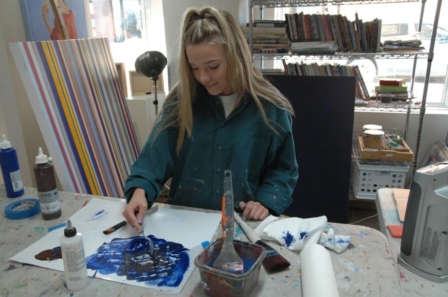 Crowley+paints+the+foundation+of+a+painting.+She+said+she+has+seen+the+healing+abilities+of+art+on+other+students+whom+she+has+helped+during+her+job+as+a+teaching+assistant.