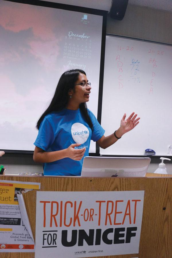 MAKING PLANS: At a UNICEF Club meeting, Viha Bynagari, club officer and sophomore, explains the phone-a-thon. Members discussed methods of bringing awareness for current issues.