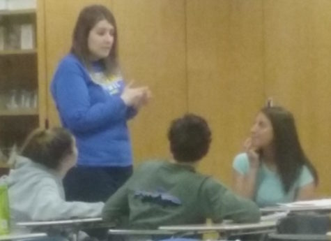 Club Med sponsor Alyssa Mastin talks with students in her principles of biomedical science class. She said,