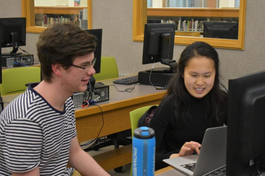 Evan+Kenyon+%28left%29%2C+Code+For+Change+Vice+President%2C+Co-Founder+and+junior+helps+Sophie+Wang%2C+club+member+and+junior%2C+set+up+coding+software.+Kenyon+said+that+the+club+plans+to+launch+the+website+soon.
