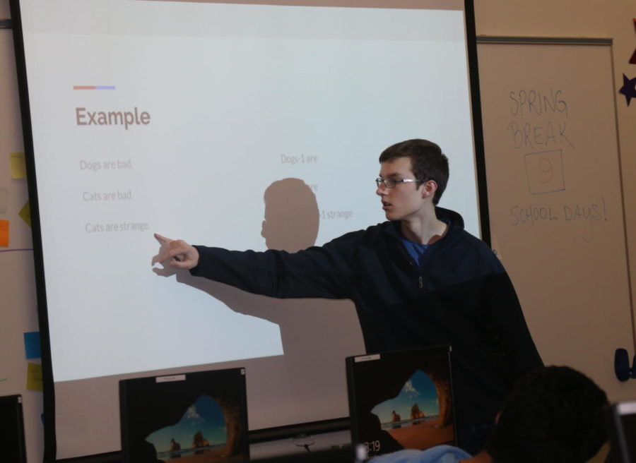 Jared Stigter, Data Club founder, president and junior, reviews N-Grams,  Neural Networks and Clustering Algorithms during a club meeting. His club focuses on using computational methods of data analysis, such as machine learning.