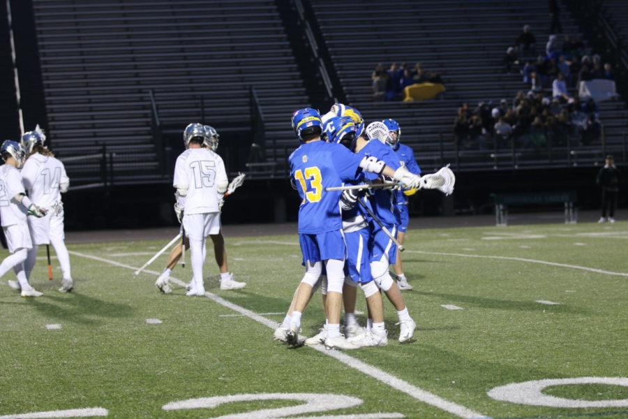 The CHS men's lacrosse team celebrates following a goal at its game against Zionsville. The hounds walked out with a win for its first game of the season.