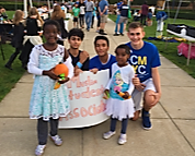 """Ismail Aqeel, MSA officer and junior (third from left), stands with fellow members of the club during an outing near the city hall. Aqeel said that volunteering at local organizations in Carmel allows the MSA to help unite the community. """"We want to make sure we are able to help in a positive manner,"""" he said."""