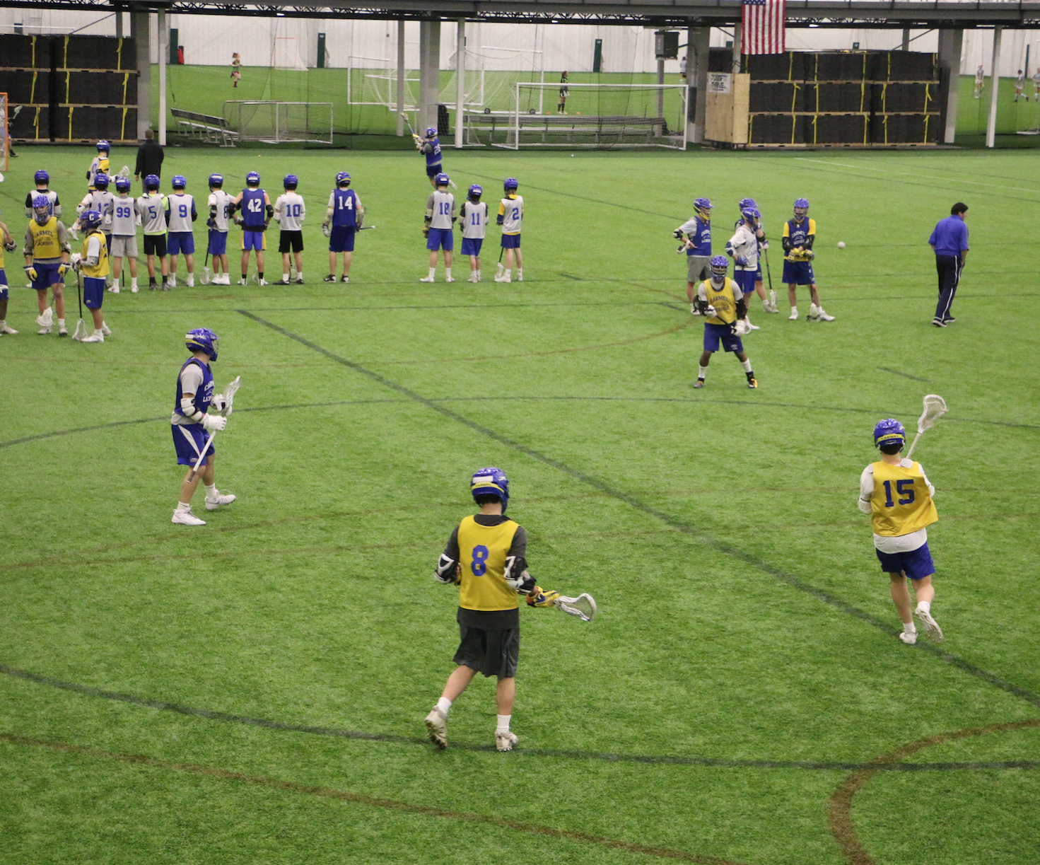 The men's Varsity lacrosse team practices during the preseason at Grand Park. The team will play its first official season game on Fri. March 16.