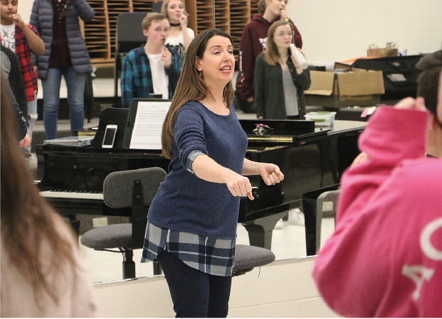 SING IT: Director Katherin Kouns gives instructions to the class. A capella groups rely solely on the sounds that are produced from their voices and other instrumental sounds from beatboxing, snapping or clapping.